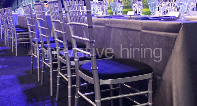 Features: Trestle Tables with Silver Tiffany Chairs
