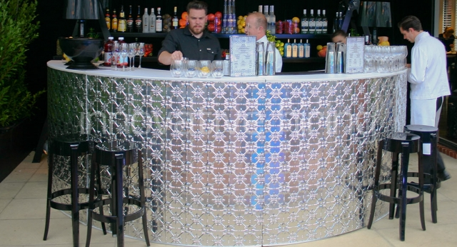 Features: Circular Pressed Metal Bar with Charles Ghost Stools