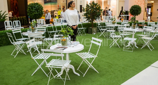 Features: New York Cafe Tables with Garden Chairs & Navy Stools