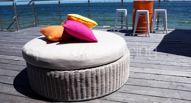 Features: Coastal Rattan Ottoman & Oil Drum with Tolix Bar Stools