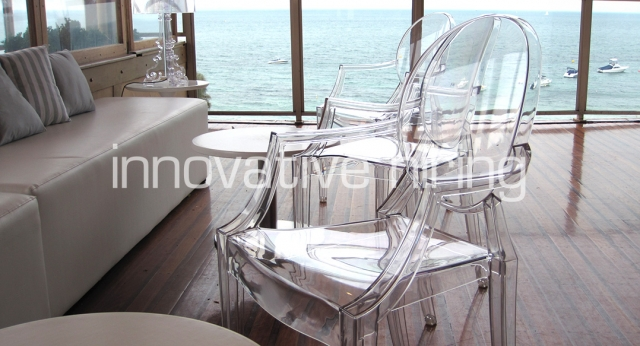 Features: Louis Ghost Chair with White Ottomans