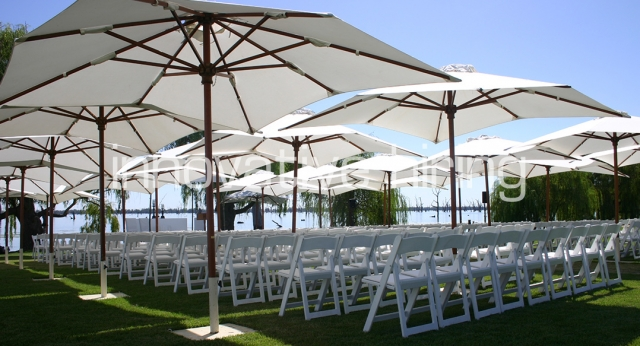 Features: Padded Folding Chairs with Cream Market Umbrellas